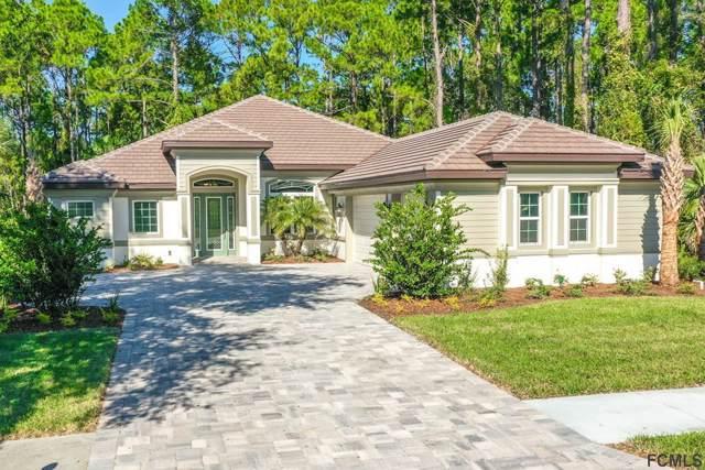 113 Emerald Lake Drive, Palm Coast, FL 32137 (MLS #252959) :: Noah Bailey Group