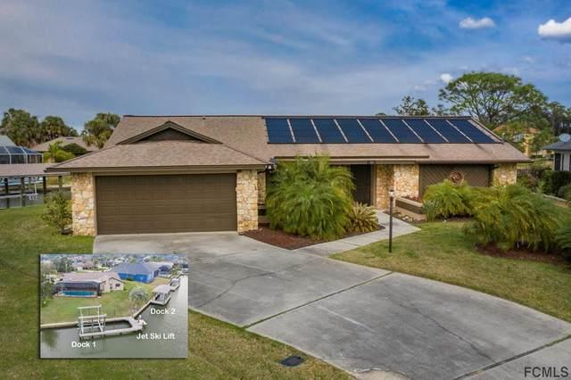 11 Carlos Court, Palm Coast, FL 32137 (MLS #254992) :: Memory Hopkins Real Estate