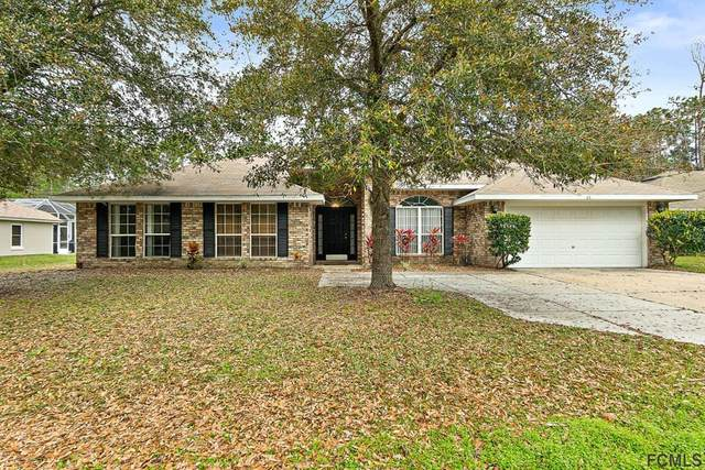 63 Woodside Drive, Palm Coast, FL 32164 (MLS #255021) :: Noah Bailey Group