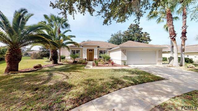 10 Oasis Circle, Palm Coast, FL 32137 (MLS #255029) :: Memory Hopkins Real Estate
