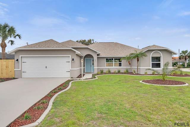 2 Carlos Court, Palm Coast, FL 32137 (MLS #255255) :: The DJ & Lindsey Team