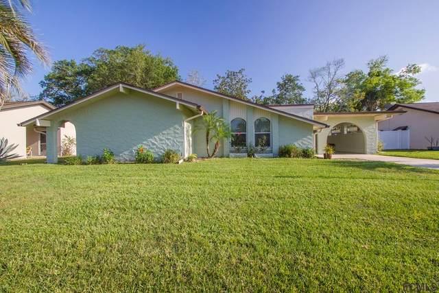 54 Farragut Drive, Palm Coast, FL 32137 (MLS #256264) :: The DJ & Lindsey Team