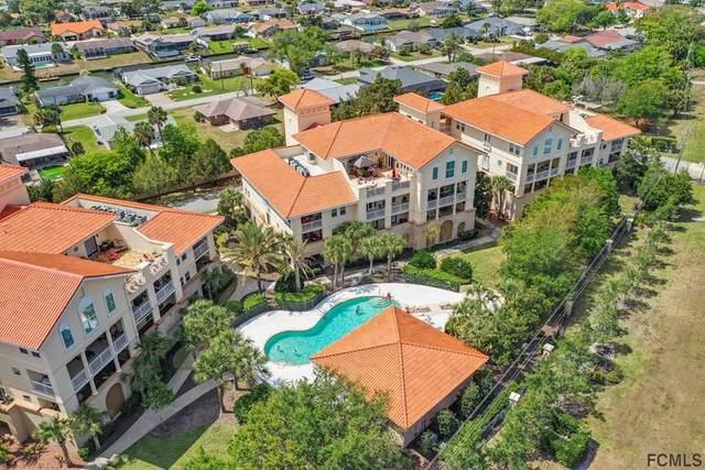 100 Bella Harbor Ct #101, Palm Coast, FL 32137 (MLS #259125) :: The DJ & Lindsey Team