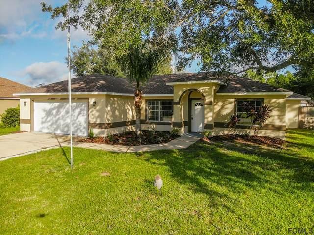 68 Langdon Drive, Palm Coast, FL 32137 (MLS #260394) :: Noah Bailey Group