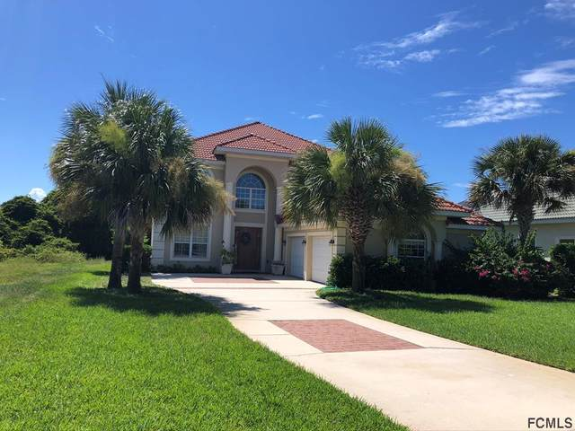 128 Heron Dr, Palm Coast, FL 32137 (MLS #262054) :: The DJ & Lindsey Team