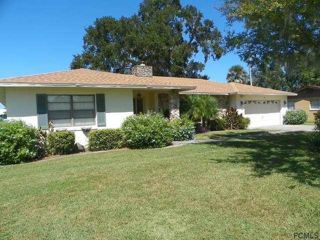 14 Ferguson Court, Palm Coast, FL 32137 (MLS #262124) :: The DJ & Lindsey Team