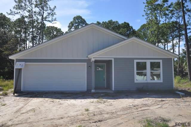 56 Pine Crest Ln, Palm Coast, FL 32164 (MLS #262187) :: The DJ & Lindsey Team