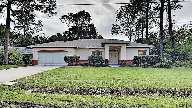 12 Bird Tree Place, Palm Coast, FL 32137 (MLS #263015) :: Memory Hopkins Real Estate