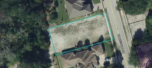25 N Lakewalk Dr, Palm Coast, FL 32137 (MLS #263454) :: Dalton Wade Real Estate Group