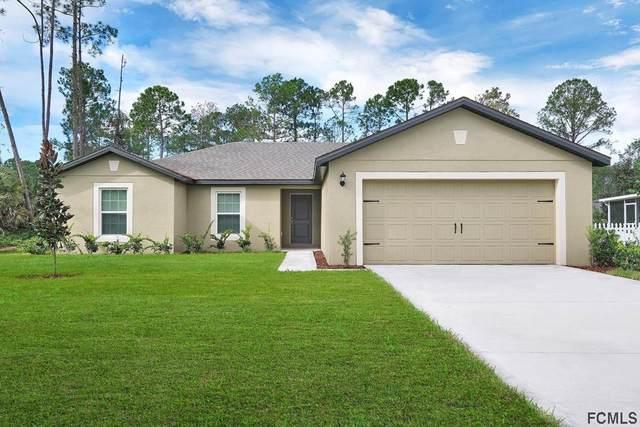 106 Persimmon Drive, Palm Coast, FL 32164 (MLS #265171) :: Dalton Wade Real Estate Group
