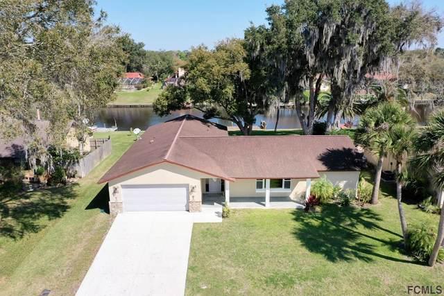 25 Farraday Lane, Palm Coast, FL 32137 (MLS #265208) :: The DJ & Lindsey Team