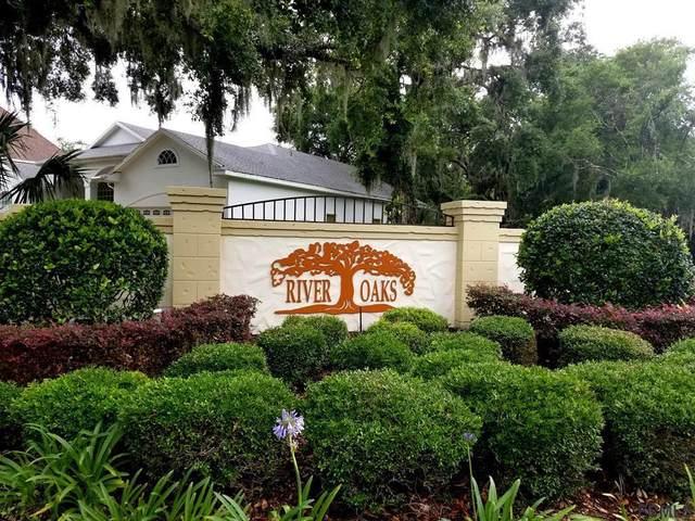 15 River Oaks Way, Palm Coast, FL 32137 (MLS #266179) :: NextHome At The Beach II