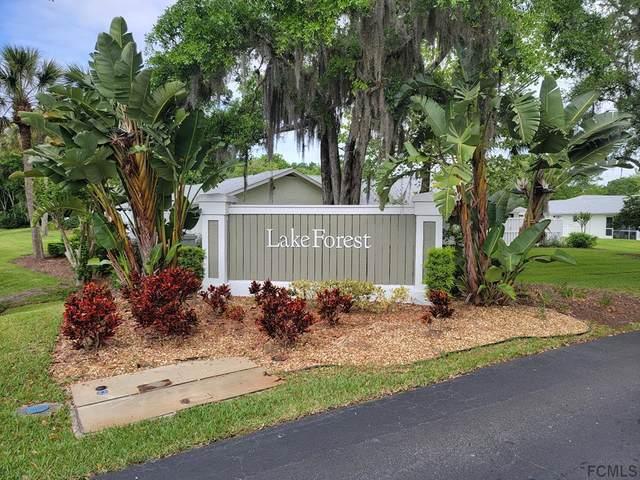 16 Lake Forest Ct #16, Palm Coast, FL 32137 (MLS #266706) :: Noah Bailey Group