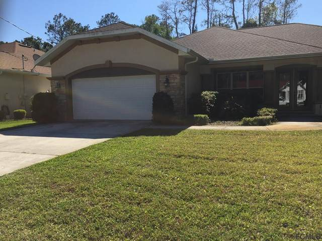94 Esperanto Drive, Palm Coast, FL 32164 (MLS #266805) :: Olde Florida Realty Group