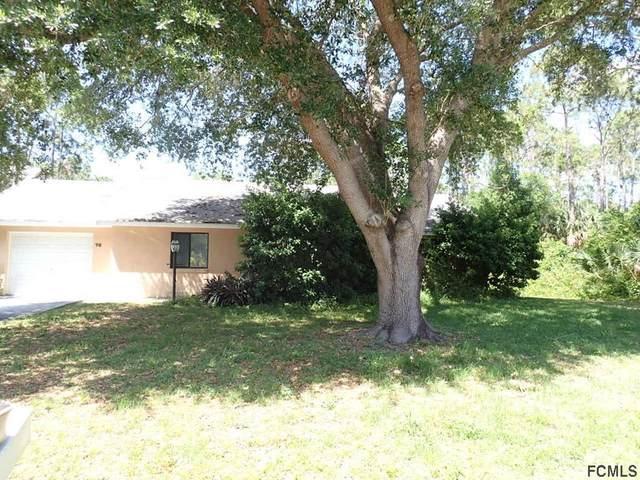 78 Whispering Pine Dr, Palm Coast, FL 32164 (MLS #267436) :: Memory Hopkins Real Estate
