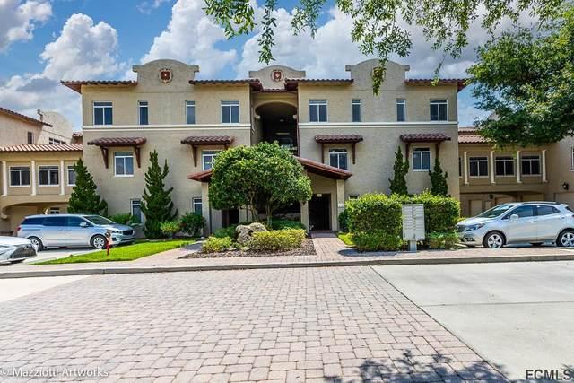 112 Club House Dr #204, Palm Coast, FL 32137 (MLS #267924) :: Noah Bailey Group