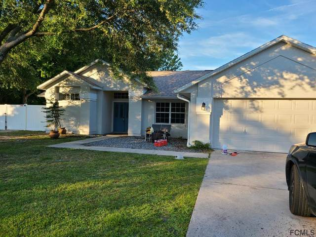 99 Persimmon Drive, Palm Coast, FL 32164 (MLS #268331) :: NextHome At The Beach II