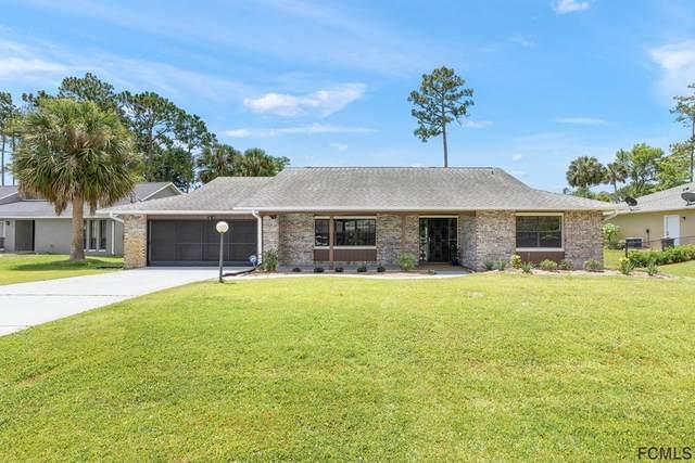 10 Parkview Drive, Palm Coast, FL 32164 (MLS #268447) :: Noah Bailey Group