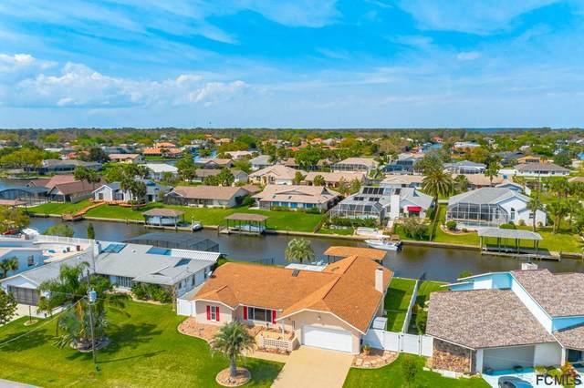 5 Chesney Ct, Palm Coast, FL 32137 (MLS #268543) :: NextHome At The Beach II