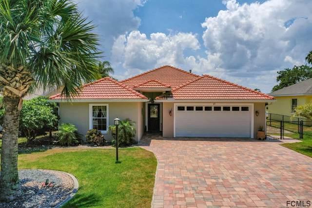 45 Comanche Court, Palm Coast, FL 32137 (MLS #268547) :: Noah Bailey Group