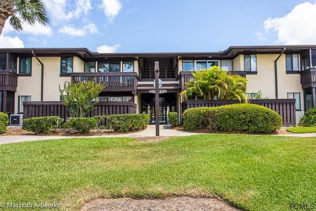 60 Club House Dr #107, Palm Coast, FL 32137 (MLS #268550) :: Noah Bailey Group