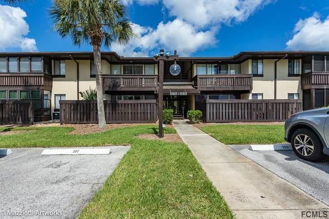 48 Club House Dr #107, Palm Coast, FL 32137 (MLS #268551) :: Noah Bailey Group