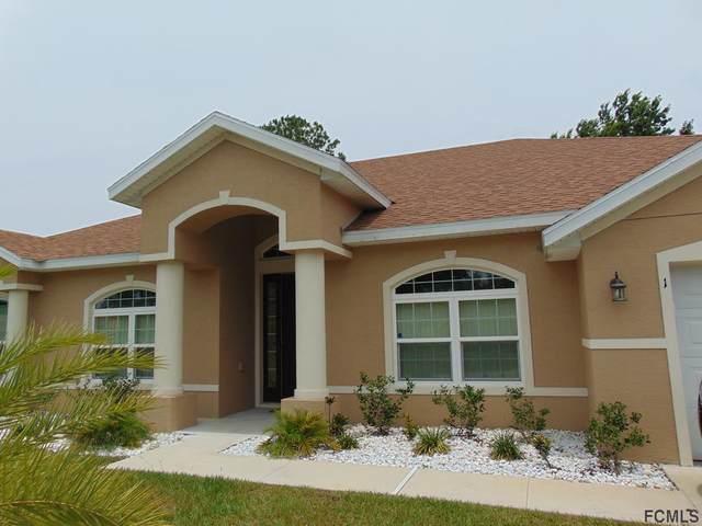 1 Wavering Place, Palm Coast, FL 32164 (MLS #268709) :: The DJ & Lindsey Team