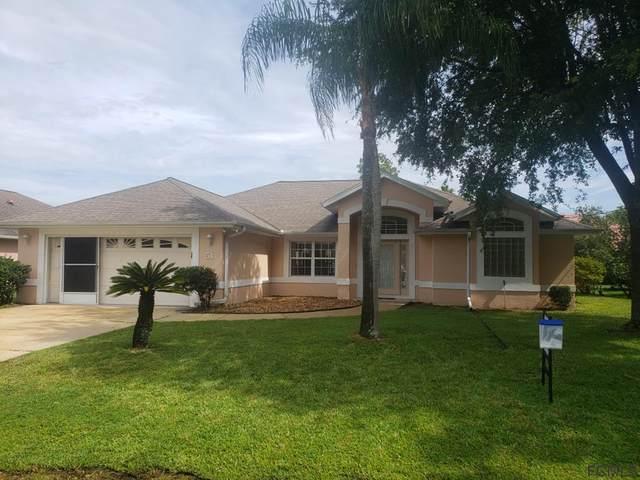 51 Woodward Ln, Palm Coast, FL 32164 (MLS #269867) :: NextHome At The Beach II