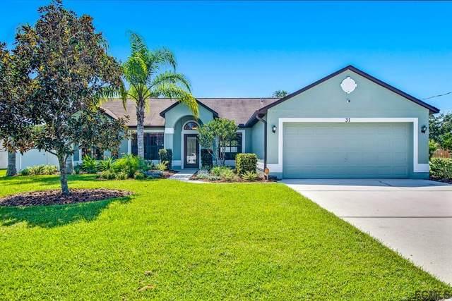 31 Bud Shire Lane, Palm Coast, FL 32137 (MLS #271363) :: The DJ & Lindsey Team