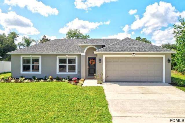 14 Roxton Lane, Palm Coast, FL 32164 (MLS #271901) :: Noah Bailey Group
