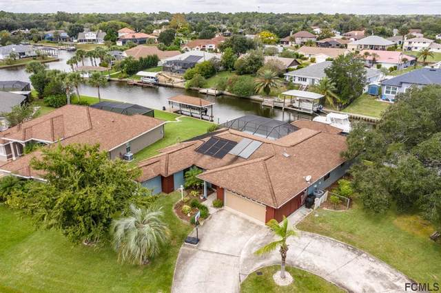 44 Colonial Ct, Palm Coast, FL 32137 (MLS #272038) :: The DJ & Lindsey Team