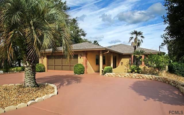 24 Comanche Court, Palm Coast, FL 32137 (MLS #272042) :: The DJ & Lindsey Team