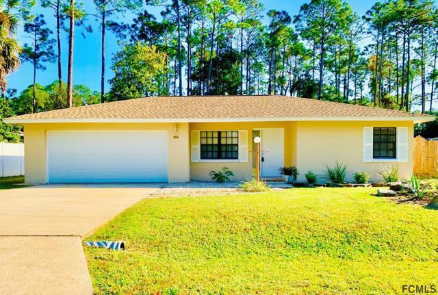 104 Beacon Mill Ln, Palm Coast, FL 32137 (MLS #243904) :: Memory Hopkins Real Estate