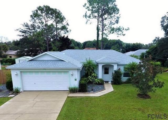 34 Pebble Wood Ln, Palm Coast, FL 32164 (MLS #261788) :: The DJ & Lindsey Team