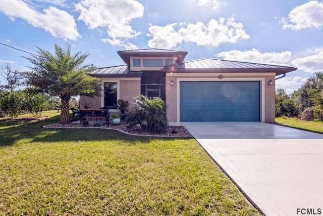 12 Mahoe Dr N, Palm Coast, FL 32137 (MLS #263897) :: Dalton Wade Real Estate Group