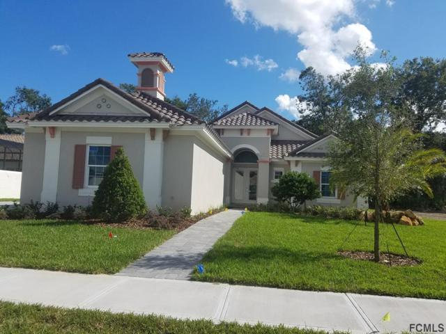 18 New Water Oak Dr, Palm Coast, FL 32137 (MLS #237106) :: Memory Hopkins Real Estate