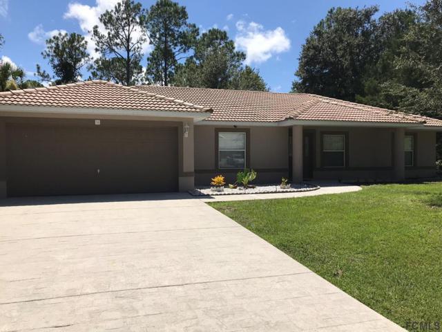 56 Pine Circle Dr, Palm Coast, FL 32164 (MLS #240627) :: Memory Hopkins Real Estate