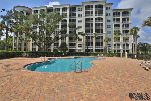 146 Palm Coast Resort Blvd #102, Palm Coast, FL 32137 (MLS #243416) :: RE/MAX Select Professionals