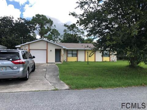 216 NW Beechwood Ln, Palm Coast, FL 32137 (MLS #250470) :: RE/MAX Select Professionals