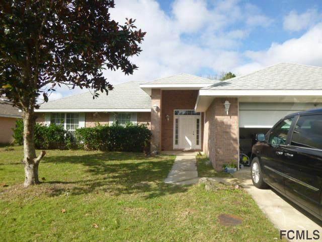 15 Flemingwood Lane, Palm Coast, FL 32137 (MLS #264977) :: The DJ & Lindsey Team
