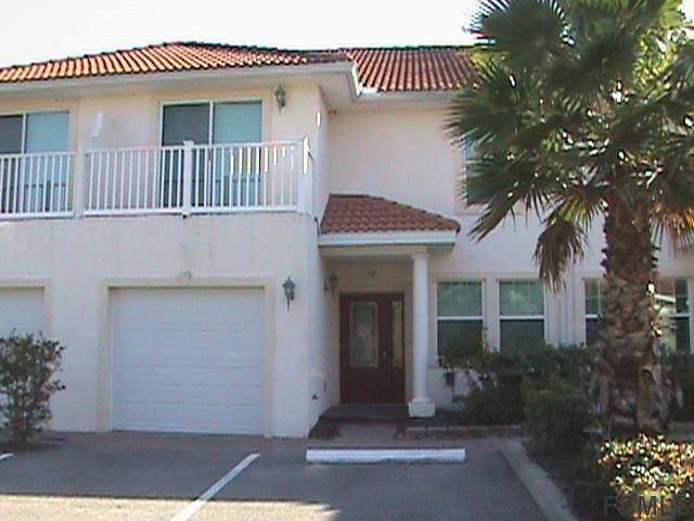 50 Palm Harbor Village Way #33, Palm Coast, FL 32137 (MLS #265188) :: The DJ & Lindsey Team