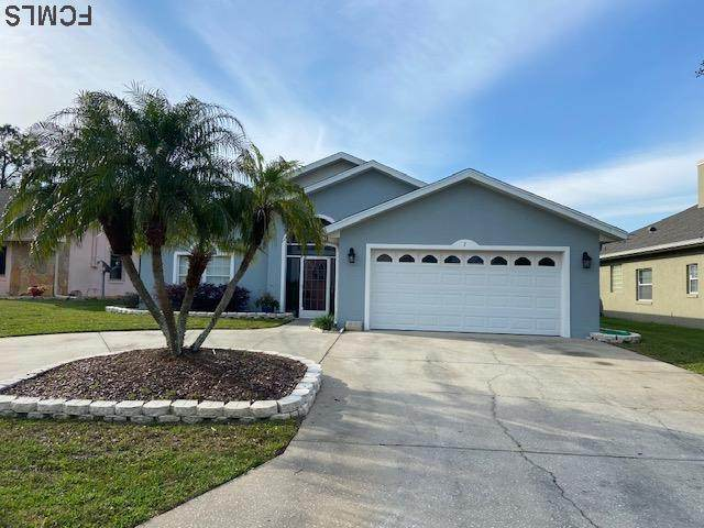 7 Carollo Ct, Palm Coast, FL 32137 (MLS #266735) :: Noah Bailey Group