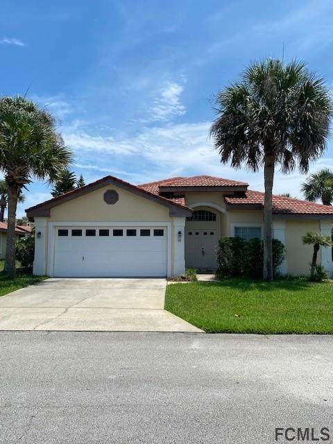 26 San Carlos Drive, Palm Coast, FL 32137 (MLS #268429) :: Olde Florida Realty Group