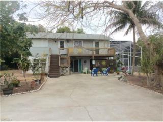 14300 Windsong Ln, Bokeelia, FL 33922 (MLS #217019406) :: The New Home Spot, Inc.