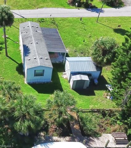 1123 Dolphin Ln, Moore Haven, FL 33471 (MLS #218073995) :: Clausen Properties, Inc.