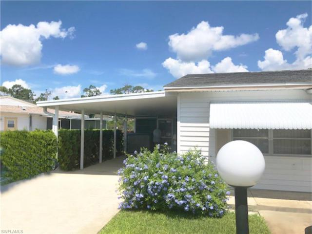 40 Pinewood Blvd, Lehigh Acres, FL 33936 (#219040649) :: The Dellatorè Real Estate Group