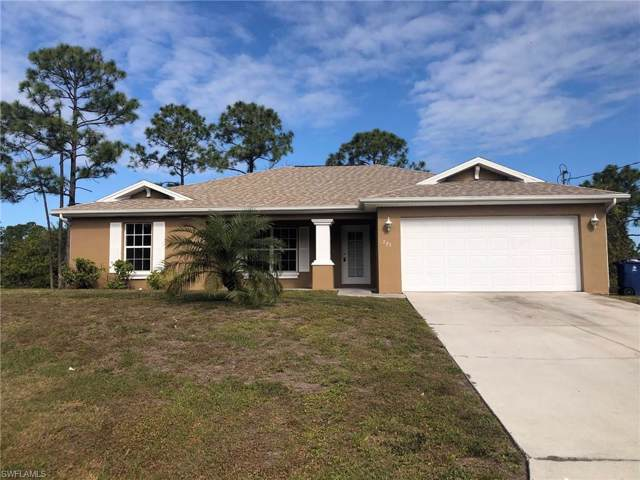 725 Newell St E, Lehigh Acres, FL 33974 (MLS #220007911) :: Clausen Properties, Inc.