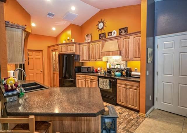 457 Greenbriar Boulevard, Lehigh Acres, FL 33972 (#220048732) :: The Dellatorè Real Estate Group