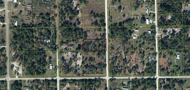 120 N Jinete Street, MONTURA RANCHES, FL 33440 (#220059809) :: The Dellatorè Real Estate Group