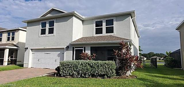 10317 Canal Brook Lane, Lehigh Acres, FL 33936 (MLS #220062610) :: The Naples Beach And Homes Team/MVP Realty